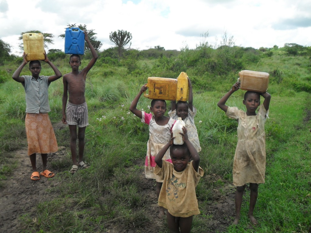 Children carrying water on their heads